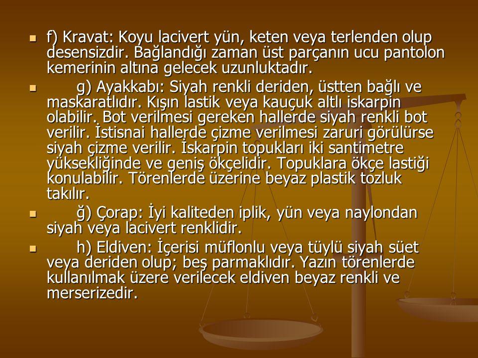 f) Kravat: Koyu lacivert yün, keten veya terlenden olup desensizdir