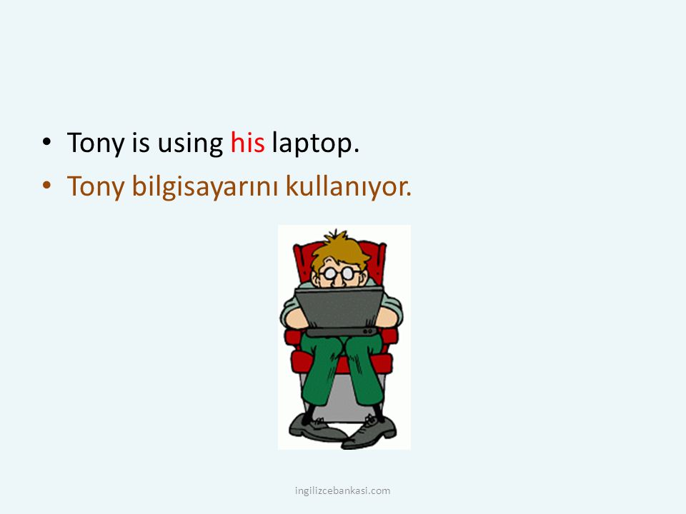 Tony is using his laptop. Tony bilgisayarını kullanıyor.