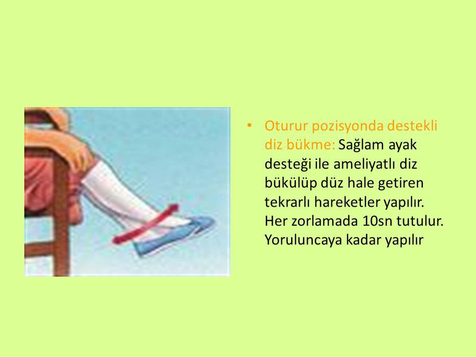 Oturur pozisyonda destekli diz bükme: Sağlam ayak desteği ile ameliyatlı diz bükülüp düz hale getiren tekrarlı hareketler yapılır.