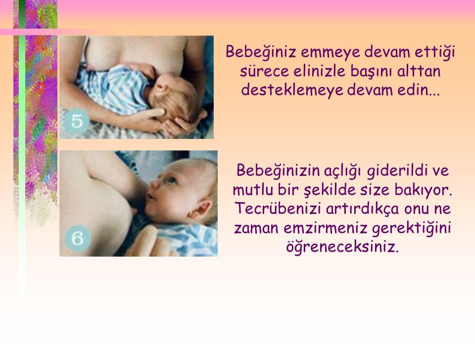 Bebeğiniz emmeye devam ettiği sürece elinizle başını alttan desteklemeye devam edin...