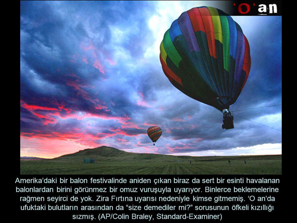 Amerika'daki bir balon festivalinde aniden çıkan biraz da sert bir esinti havalanan balonlardan birini görünmez bir omuz vuruşuyla uyarıyor.
