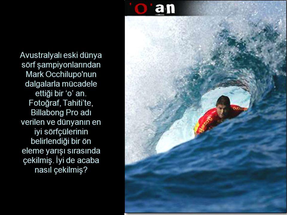 Avustralyalı eski dünya sörf şampiyonlarından Mark Occhilupo nun dalgalarla mücadele ettiği bir 'o' an.