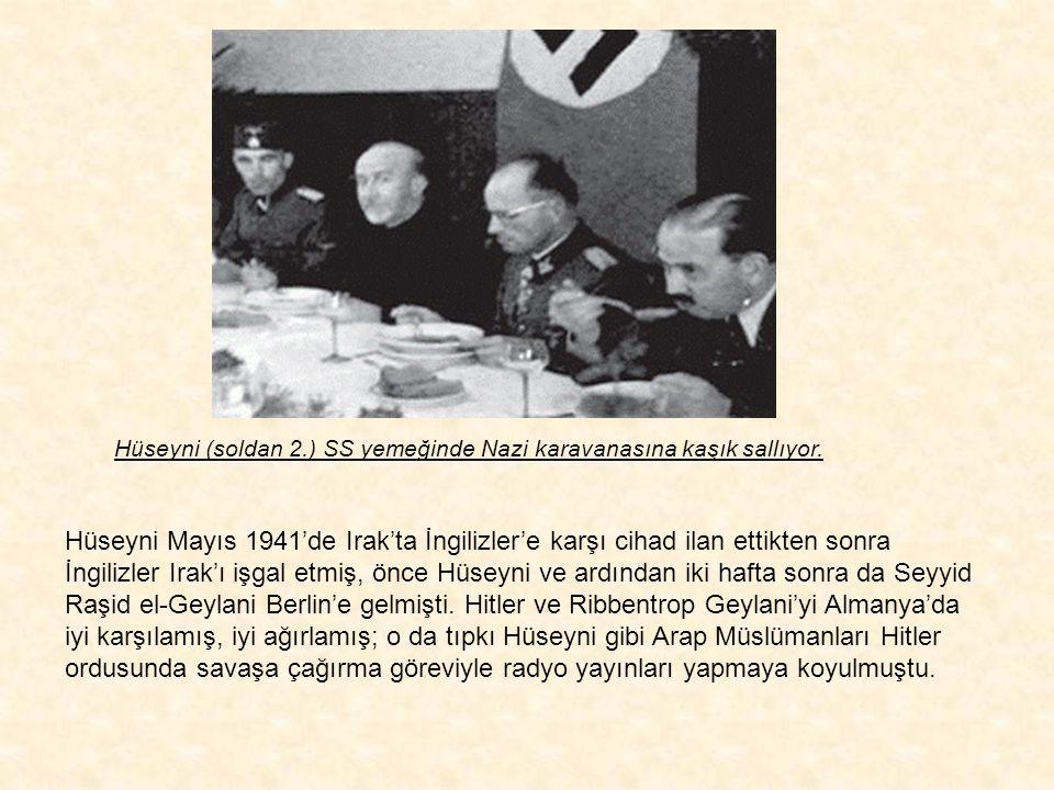 Hüseyni (soldan 2.) SS yemeğinde Nazi karavanasına kaşık sallıyor.