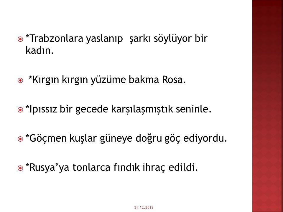 *Trabzonlara yaslanıp şarkı söylüyor bir kadın.
