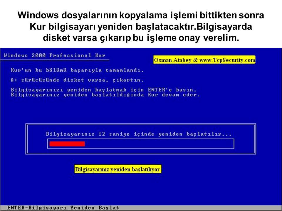 Windows dosyalarının kopyalama işlemi bittikten sonra Kur bilgisayarı yeniden başlatacaktır.Bilgisayarda disket varsa çıkarıp bu işleme onay verelim.