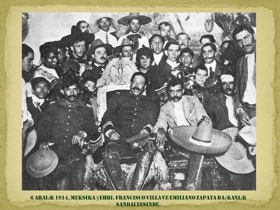 6 Aralık 1914, Meksika Şehri. Francisco Villa ve Emiliano Zapata başkanlık sandalyesinde.