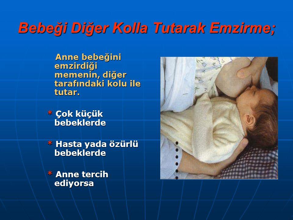 Bebeği Diğer Kolla Tutarak Emzirme;