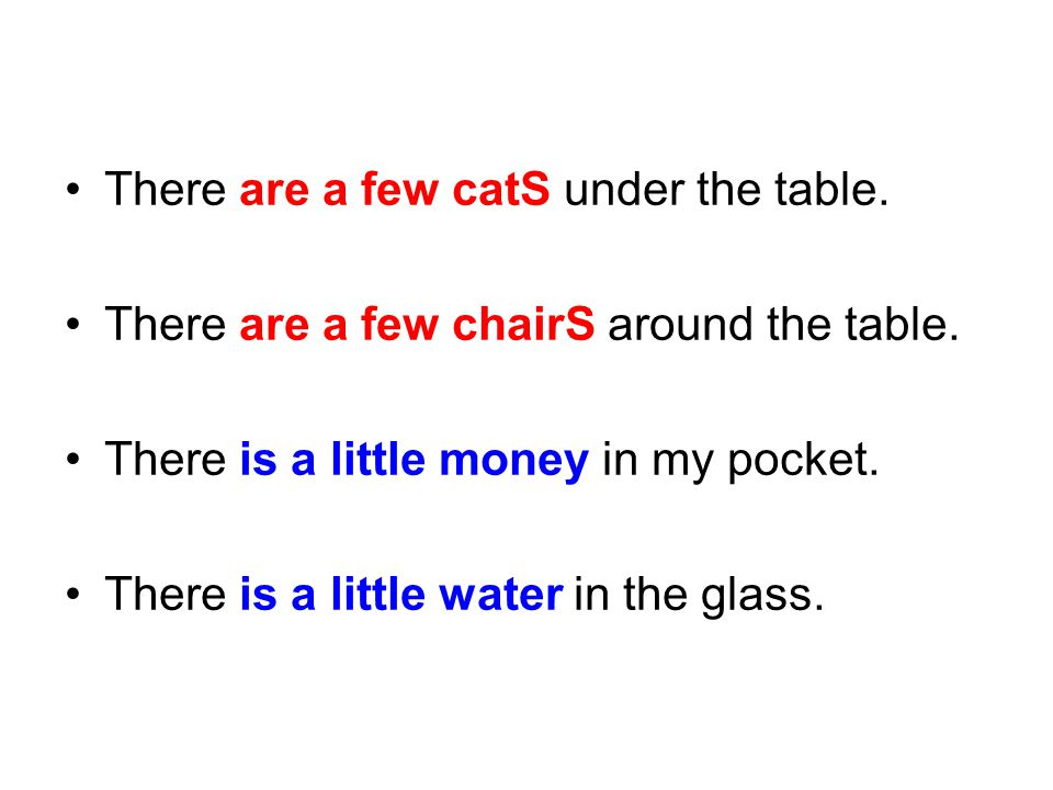 There are a few catS under the table.