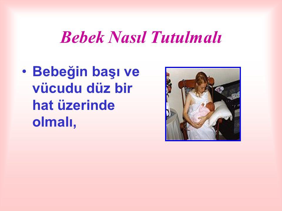 Bebek Nasıl Tutulmalı Bebeğin başı ve vücudu düz bir hat üzerinde olmalı,