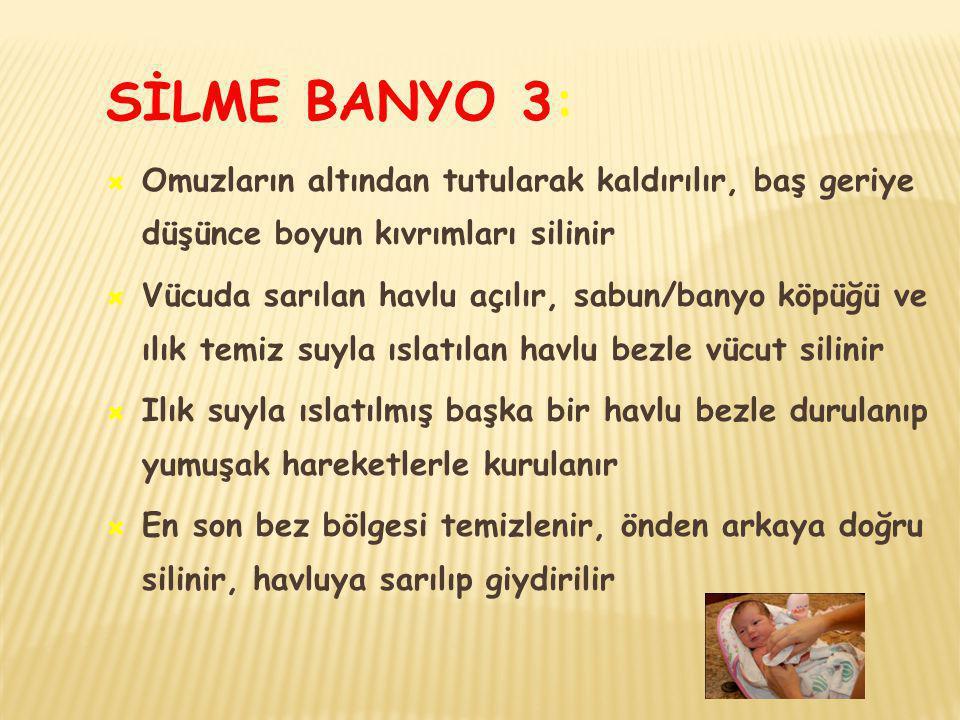 SİLME BANYO 3: Omuzların altından tutularak kaldırılır, baş geriye düşünce boyun kıvrımları silinir.