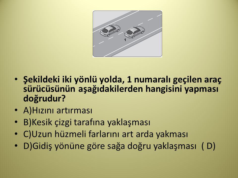 Şekildeki iki yönlü yolda, 1 numaralı geçilen araç sürücüsünün aşağıdakilerden hangisini yapması doğrudur