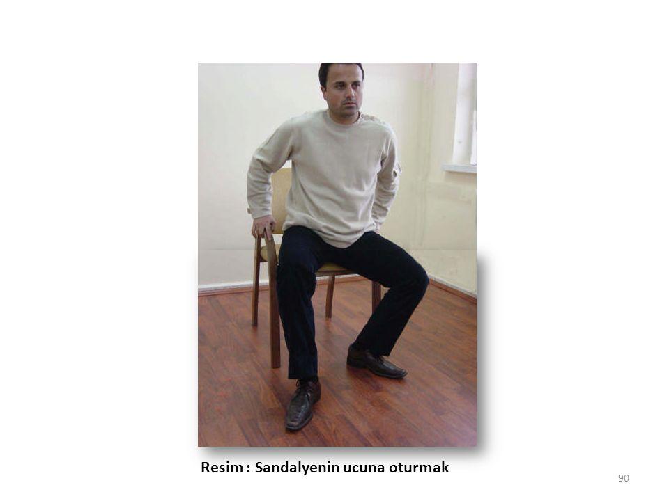 Resim : Sandalyenin ucuna oturmak