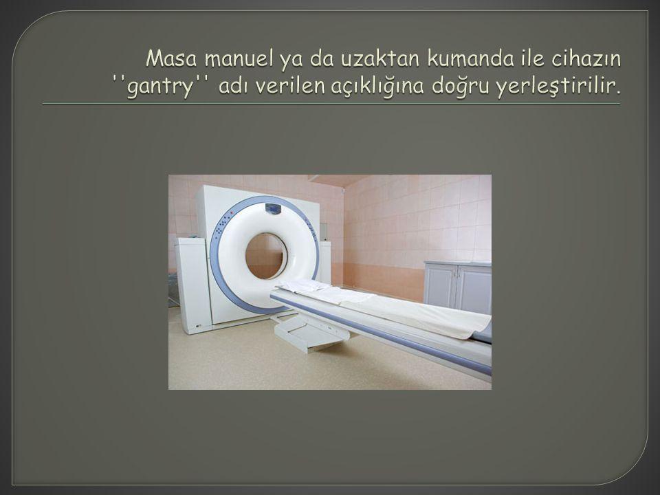 Masa manuel ya da uzaktan kumanda ile cihazın gantry adı verilen açıklığına doğru yerleştirilir.