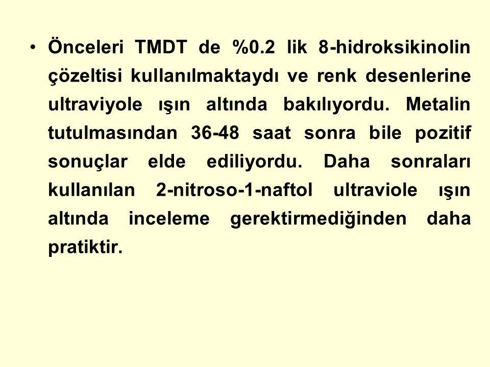 Önceleri TMDT de %0.2 lik 8-hidroksikinolin çözeltisi kullanılmaktaydı ve renk desenlerine ultraviyole ışın altında bakılıyordu.
