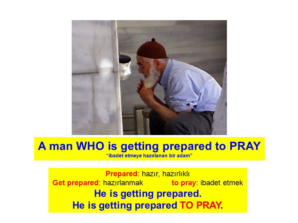 A man WHO is getting prepared to PRAY