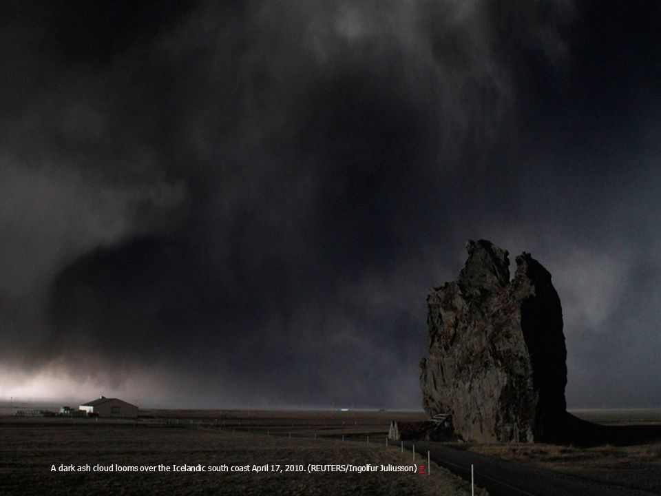 A dark ash cloud looms over the Icelandic south coast April 17, 2010
