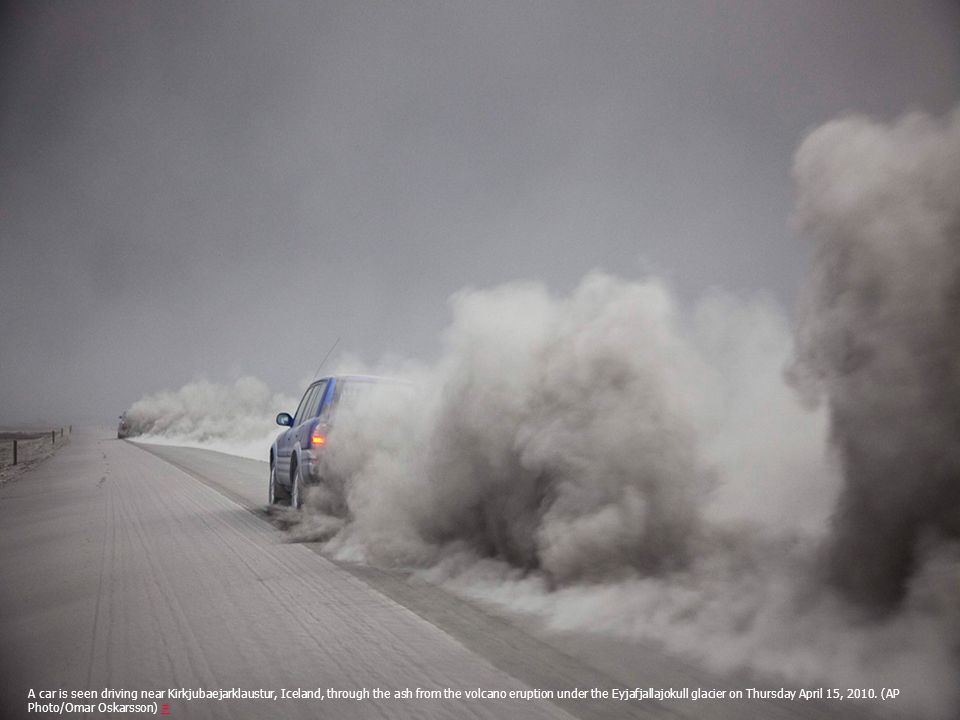 A car is seen driving near Kirkjubaejarklaustur, Iceland, through the ash from the volcano eruption under the Eyjafjallajokull glacier on Thursday April 15, 2010.