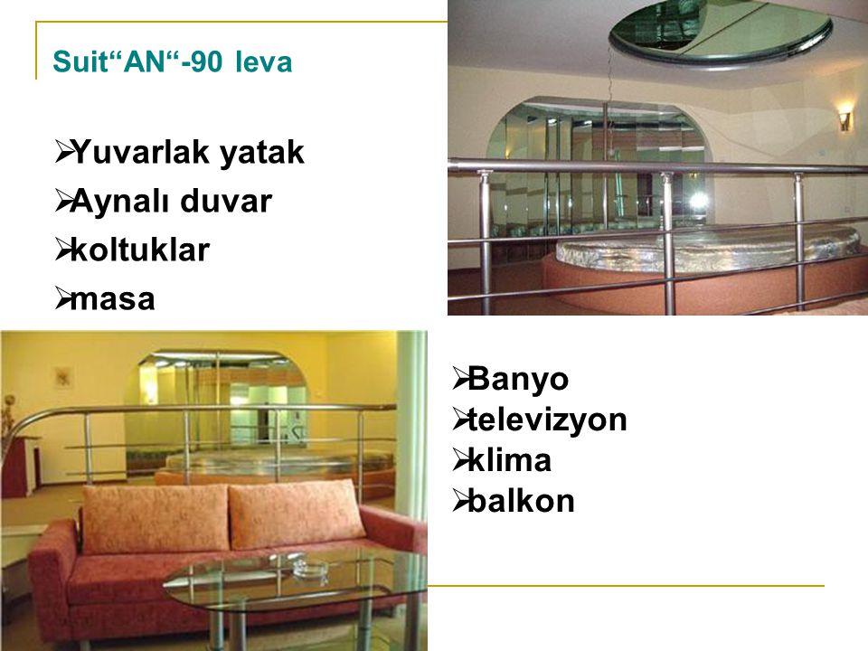 Yuvarlak yatak Aynalı duvar koltuklar masa Banyo televizyon klima
