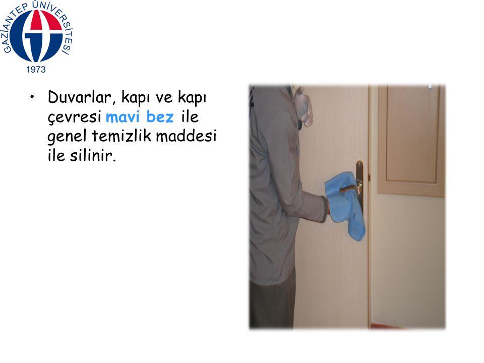 Duvarlar, kapı ve kapı çevresi mavi bez ile genel temizlik maddesi ile silinir.