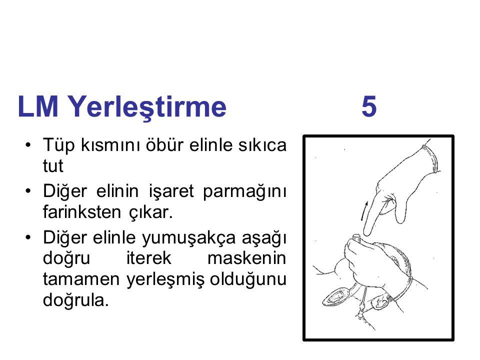 LM Yerleştirme 5 Tüp kısmını öbür elinle sıkıca tut