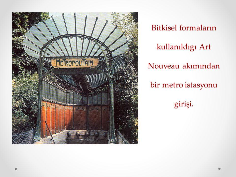 Bitkisel formaların kullanıldıgı Art Nouveau akımından bir metro istasyonu girişi.