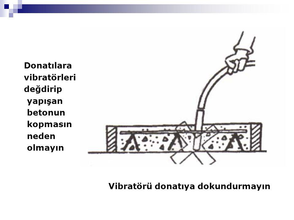Donatılara vibratörleri. değdirip. yapışan. betonun.