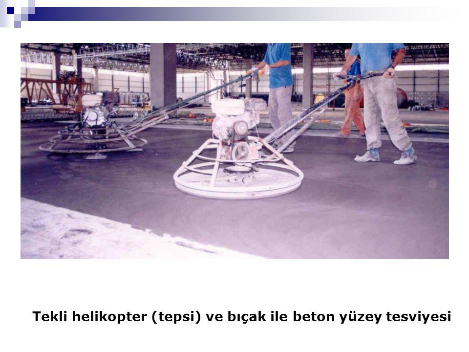 Tekli helikopter (tepsi) ve bıçak ile beton yüzey tesviyesi