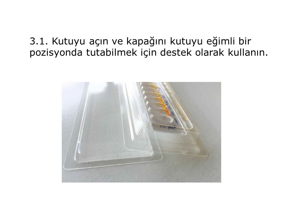 3.1. Kutuyu açın ve kapağını kutuyu eğimli bir pozisyonda tutabilmek için destek olarak kullanın.