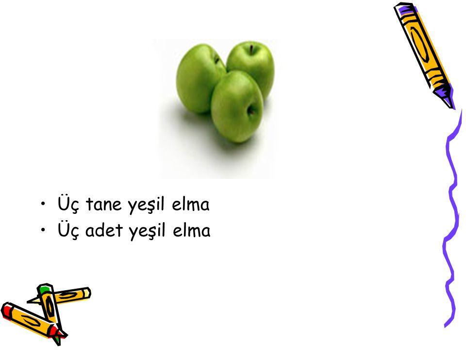 Üç tane yeşil elma Üç adet yeşil elma