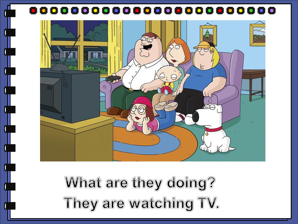 What are they doing They are watching TV.