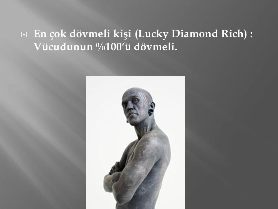 En çok dövmeli kişi (Lucky Diamond Rich) : Vücudunun %100'ü dövmeli.