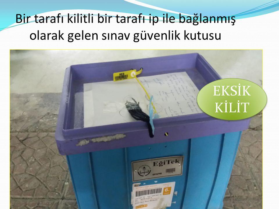 Bir tarafı kilitli bir tarafı ip ile bağlanmış olarak gelen sınav güvenlik kutusu