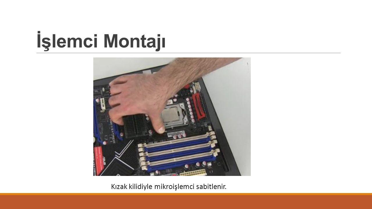 İşlemci Montajı Kızak kilidiyle mikroişlemci sabitlenir.