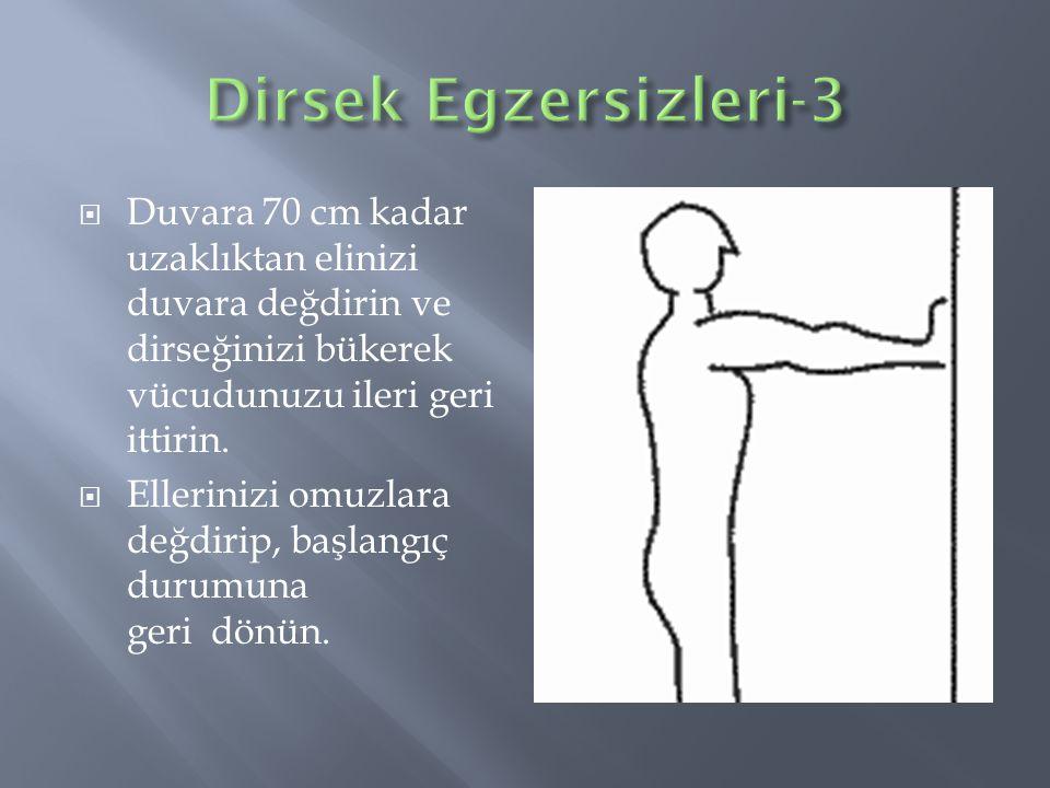 Dirsek Egzersizleri-3 Duvara 70 cm kadar uzaklıktan elinizi duvara değdirin ve dirseğinizi bükerek vücudunuzu ileri geri ittirin.