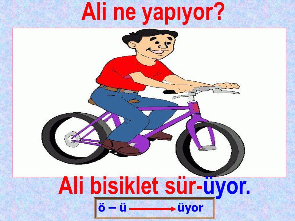 Ali ne yapıyor Ali bisiklet sür-üyor.
