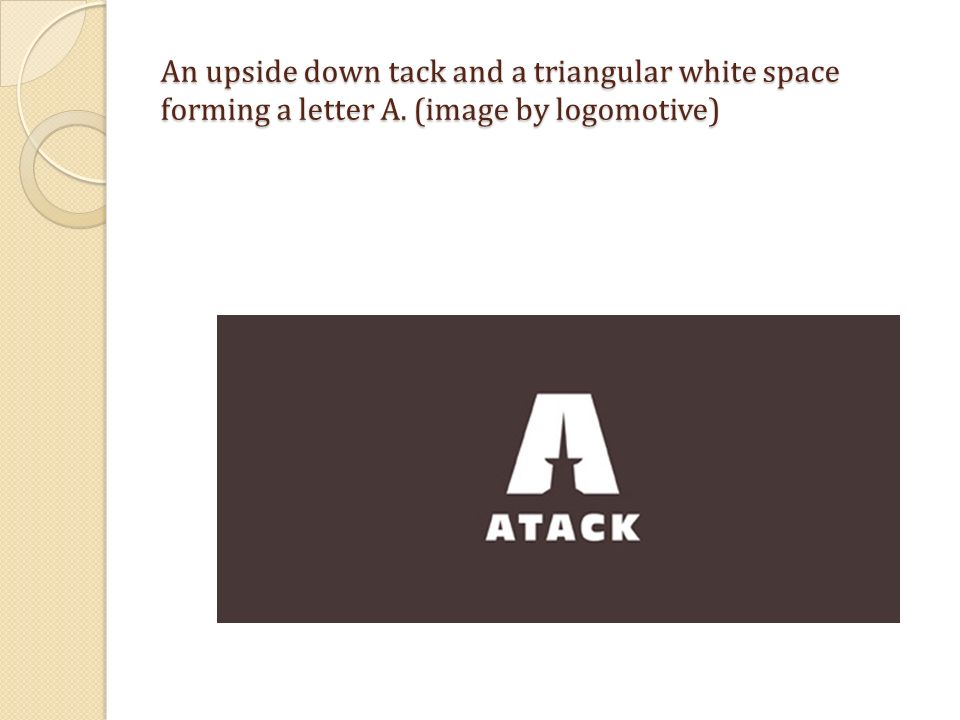 An upside down tack and a triangular white space forming a letter A