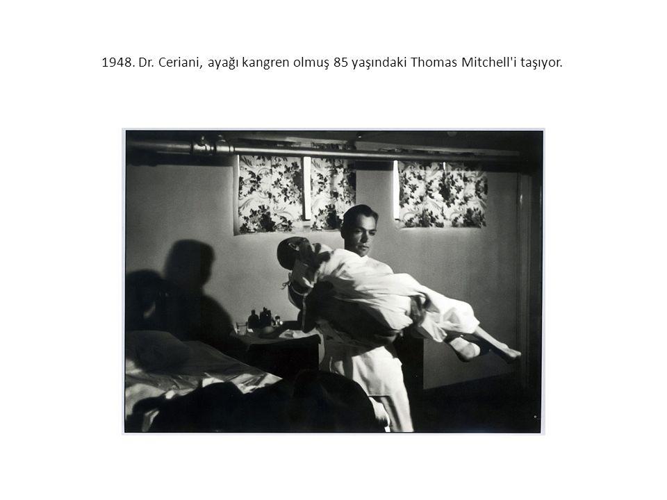 1948. Dr. Ceriani, ayağı kangren olmuş 85 yaşındaki Thomas Mitchell i taşıyor.